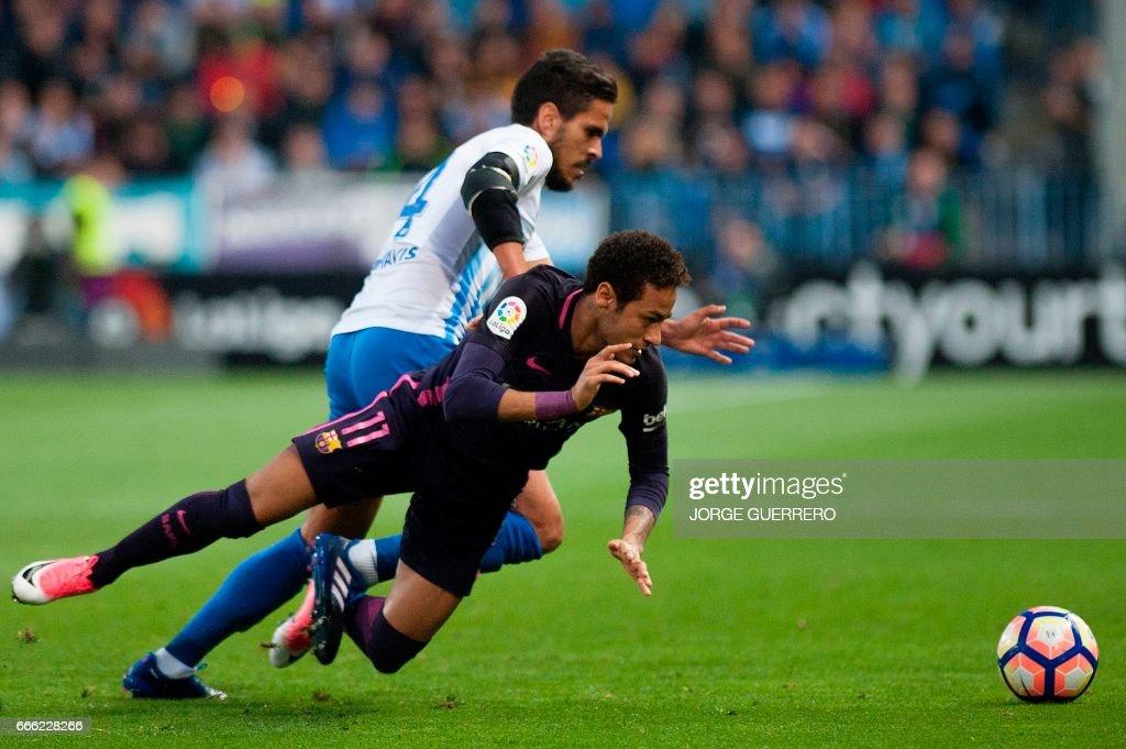 Malaga's midfielder Jose Luis Garcia Recio (L) vies with Barcelona's Brazilian forward Neymar da Silva during the Spanish league football match Malaga CF vs FC Barcelona at La Rosaleda stadium in Malaga on April 8, 2017. /