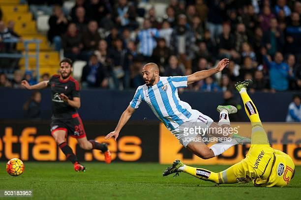 Malaga's Moroccan forward Nordin Amrabat vies with Celta Vigo's goalkeeper Ruben Blanco during the Spanish league football match Malaga CF vs RC...
