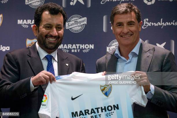 Malaga's new coach Jose Miguel Gonzalez Martin del Campo aka Michel poses with Malaga CF's chairman Sheikh Abdallah Ben Nasser AlThani during his...