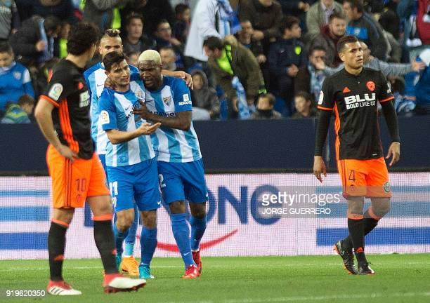 Malaga's Nigerian forward Brown Ideye celebrates a goal with Argentinian midfielder Gonzalo Castro Chory during the Spanish league football match...