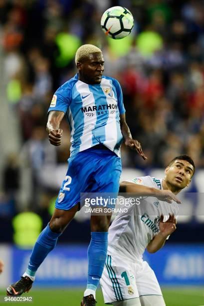 Malaga's Nigerian forward Brown Ideye vies with Real Madrid's Brazilian midfielder Casemiro during the Spanish league footbal match between Malaga CF...