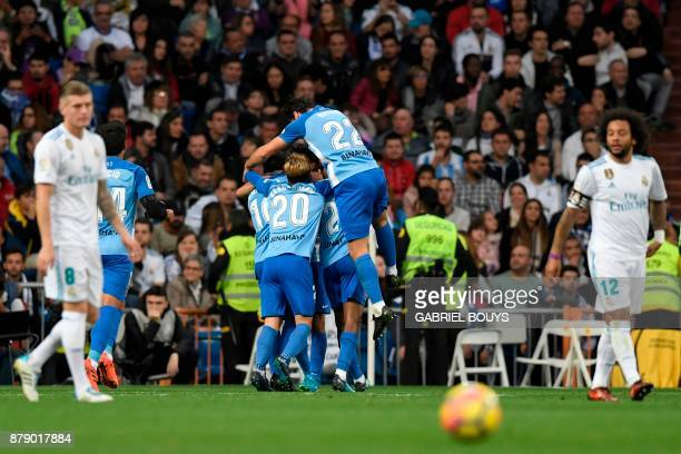 Malaga´s players celebrate after scoring during the Spanish league football match Real Madrid CF against Malaga CF on 25 November 2017 at the...