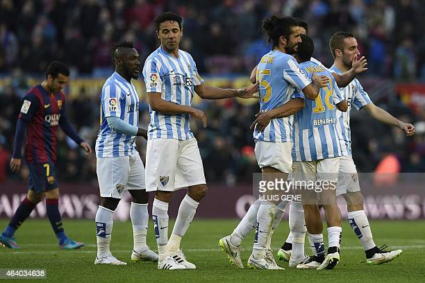 Malaga's players celebrate after the Spanish league football match FC Barcelona vs Malaga CF at the Camp Nou stadium in Barcelona on February 21 2015...