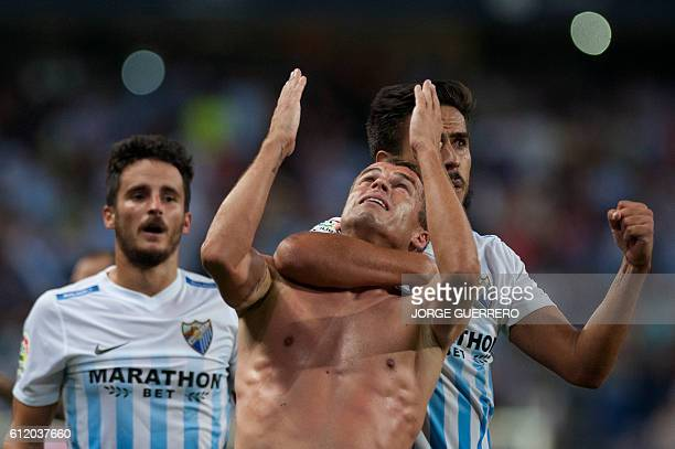 Malaga's Portuguese midfielder Duda celebrates after scoring during the Spanish league football match Malaga CF vs Athletic Club Bilbao at La...