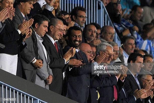 Malaga's Qatari president Sheikh Abdullah Al Thani smiles at the end of the UEFA Champions league football match Malaga CF vs AC Milan on October 24...