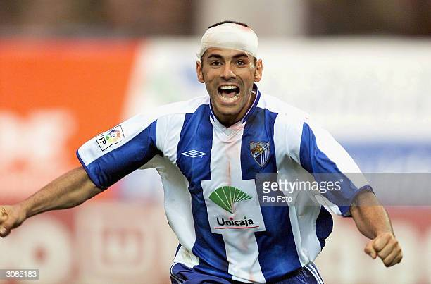 Malaga's Salva Ballesta celebrates scoring during the Malaga v Athletic Bilbao La Liga match played at the La Rosaleda stadium March 14 2004 in...