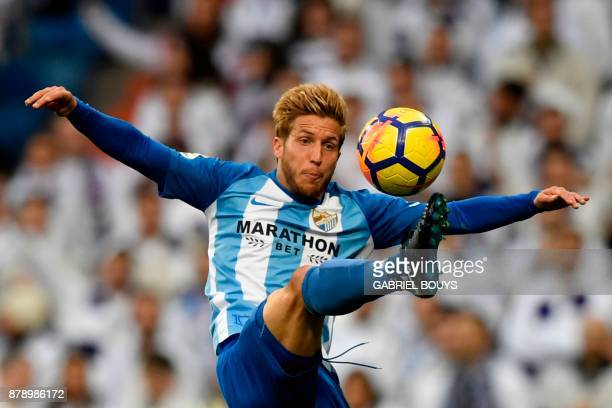 Malaga's Spanish midfielder Keko Gontan controls the ball during the Spanish league football match Real Madrid CF against Malaga CF on 25 November...