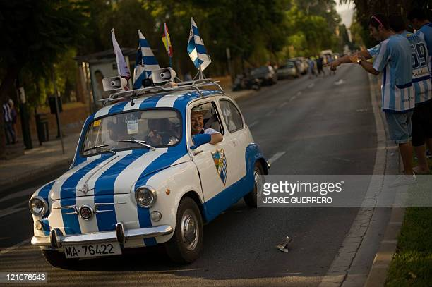 Malaga's supporters driving a car with the colors of Malaga CF before attending the Trofeo Costa del Sol football match against Penarol at the...