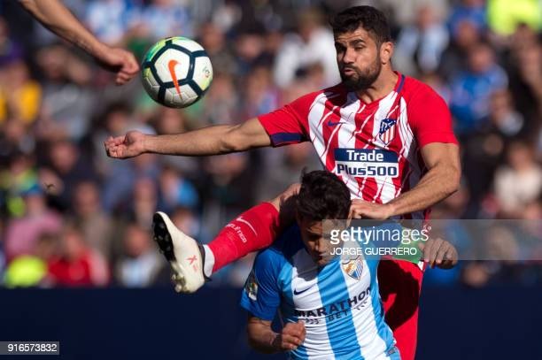Malaga's Venezuelan defender Roberto Jose Rosales vies with Atletico Madrid's forward Diego Costa during the Spanish league football match between...