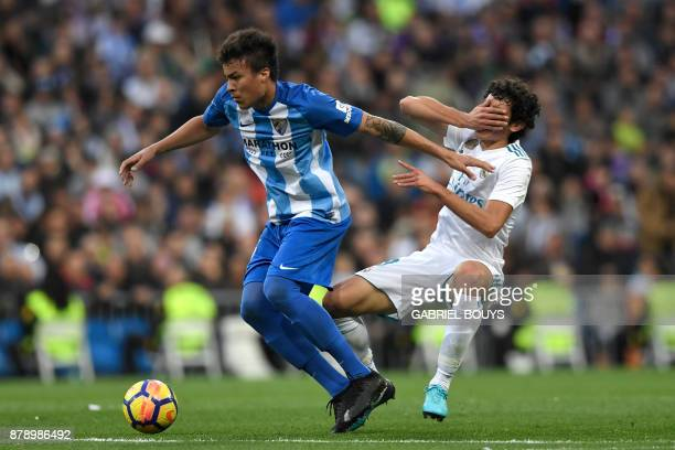 Malaga's Venezuelan forward Adalberto Penaranda vies for the ball with Real Madrid's Spanish defender Jesus Vallejo during the Spanish league...