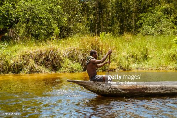 A Malagasy fisherman rowing