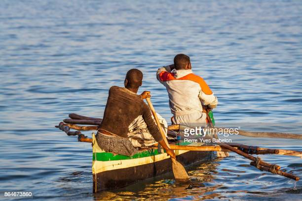 malagasy fishermen rowing - dugout canoe stock photos and pictures