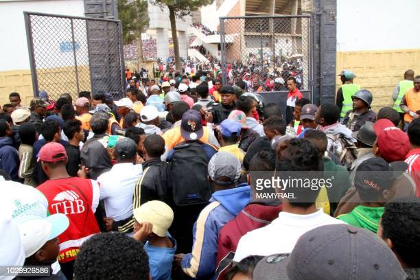 Malagasy people queue outside a football stadium waiting to enter and attend the African Cup of Nations qualifier match between Senegal and...