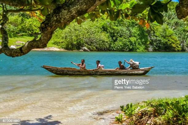 Malagasy people rowing