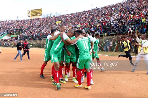 Malagasy players celebrate after scoring a goal against Senegal during their Africa Cup of Nations 2019 qualifier on September 9 2018 in Antananarivo...