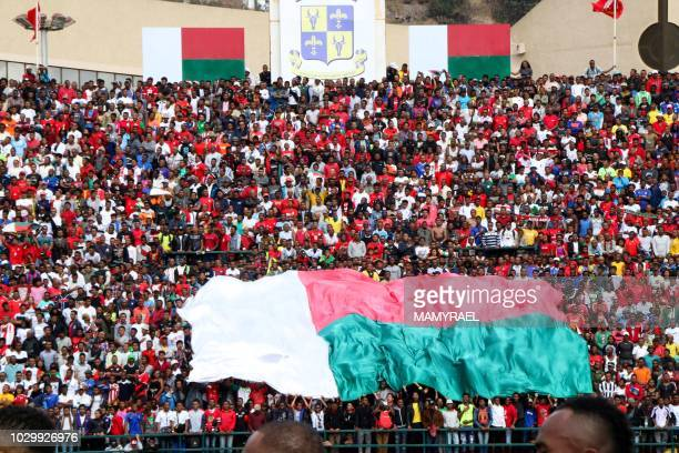 Malagasy supporters cheer during the Africa Cup of Nations 2019 qualifier Madagascar v Senegal on September 9 2018 in Antananarivo Madagascar At...