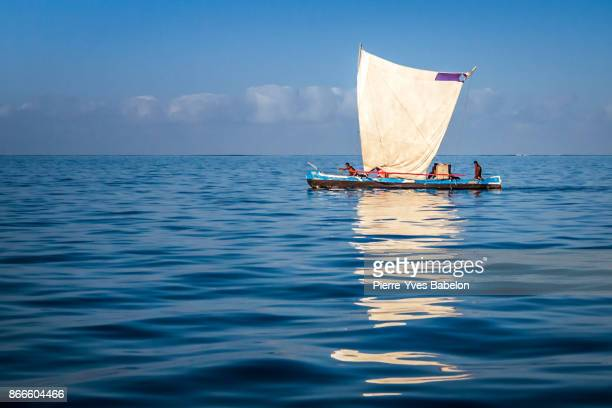 malagasy traditional outrigger canoe - dugout canoe stock photos and pictures
