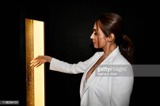 Malaika Arora and her installation are seen at the third edition of Chivas 18 Alchemy 2019 on March 16 2019 in New Delhi India
