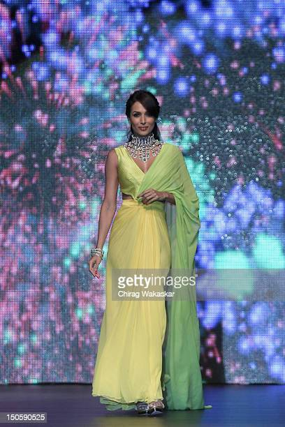Malaika Arora Khan walks the runway in a KGK Entice Jewellery design at the India International Jewellery Week 2012 Day 4 at the Grand Hyatt on...
