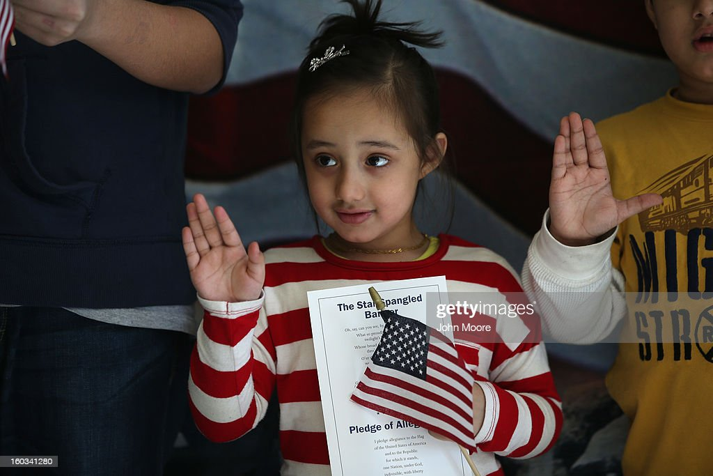 Malaika Chaudhary, who's parents immigrated to the United States from Pakistan, participates in a U.S. citizenship ceremony at the U.S. Citizenship and Immigration Services (USCIS), district office on January 29, 2013 in New York City. Some 118,000 immigrants applied for U.S. citizenship and 2,500 children received citizenship certificates in the New York City dictrict in 2012. Although underage children of naturalized immigrants usually receive U.S. citizenship, they must go through a process at the USCIS in order to receive legal certificates. Children born in the United States are American, regardless of the immigrant status of their parents.