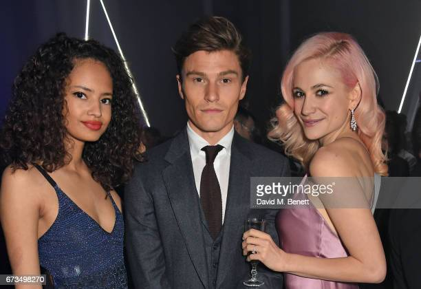 Malaika Firth Oliver Cheshire and Pixie Lott attend the OMEGA 'Lost In Space' dinner to celebrate the 60th anniversary of the OMEGA Speedmaster which...