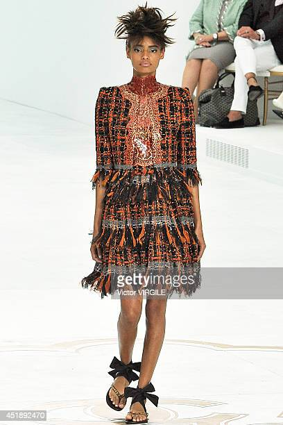 Malaika Firth walks the runway during the Chanel show as part of Paris Fashion Week Haute Couture Fall/Winter 20142015 at Grand Palais on July 8 2014...