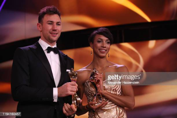 Malaika Mihambo is awarded as the female Sportler des Jahres Gala poses with Niklas Klaus who is awarded as Sportler des Jahres at Kurhaus BadenBaden...