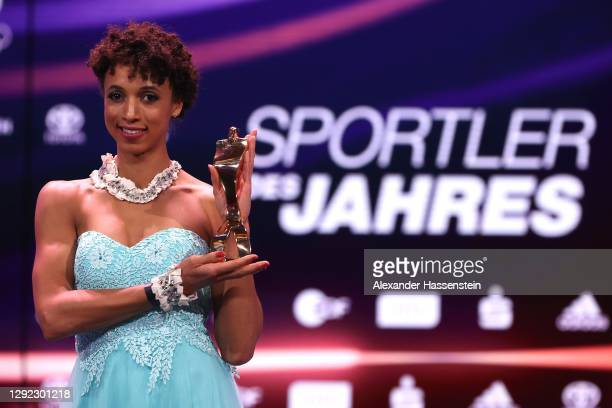 """Malaika Mihambo poses with her """"Sportswoman of the Year"""" award during the """"Sportler des Jahres"""" Gala at Kurhaus Baden-Baden on December 20, 2020 in..."""