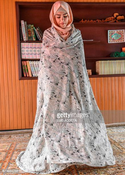 Malak Hadi Hussein from Iraq talks during an AFP interview in Bogota Colombia on April 7 2017 The Hussein family had planned to start again in the...