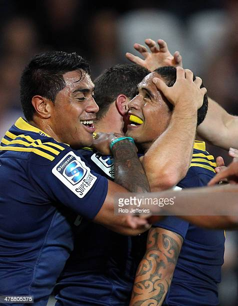 Malakai Fekitoa and Aaron Smith of the Highlanders celebrate the try of Shaun Treeby during the round five Super Rugby match between the Highlanders...
