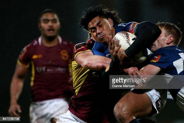 Malakai Fekitoa of Auckland is tackled by Tim Boys of Southland during the round five Mitre 10 match between Southland and Auckland at Rugby Park...
