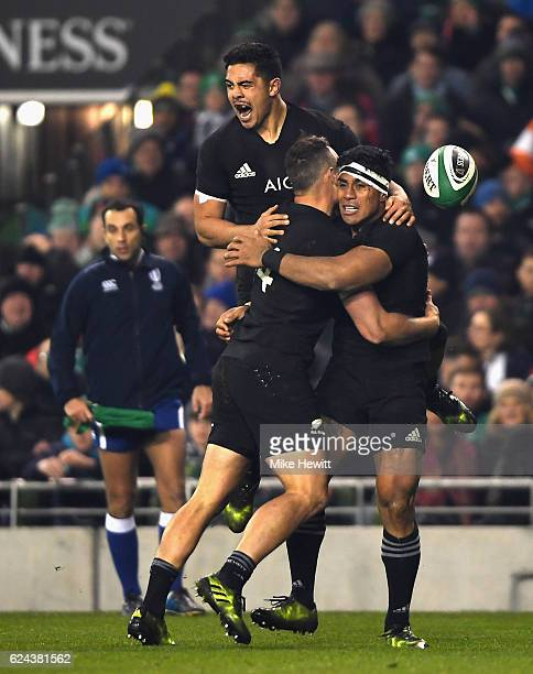 Malakai Fekitoa of New Zealand celebrates scoring a try with Israel Dagg of New Zealand and Anton LiernertBrown of New Zealand during the...