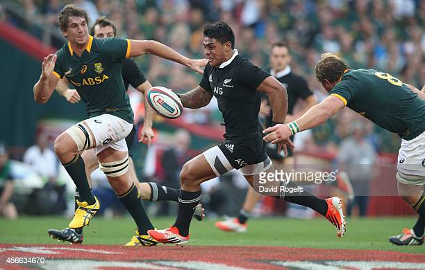 Malakai Fekitoa of the All Blacks breaks clear to score a try during the Rugby Championship match between the South African Springboks and the New...