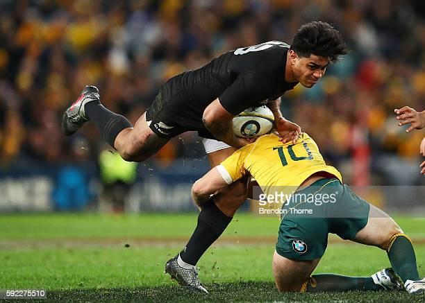 Malakai Fekitoa of the All Blacks is tackled by Bernard Foley of the Wallabies during the Bledisloe Cup Rugby Championship match between the...