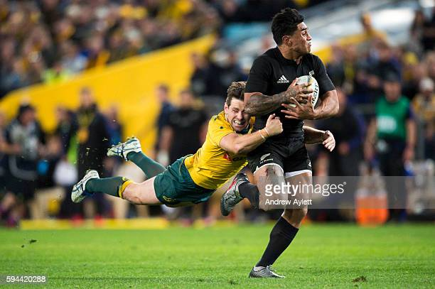 Malakai Fekitoa of the All Blacks is tackled by Bernard Foley of the Wallabies during The Rugby Championship Bledisloe Cup match between the...