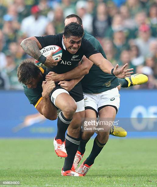 Malakai Fekitoa of the All Blacks is tackled by Eben Etzebeth and Jan Serfontein during the Rugby Championship match between the South African...
