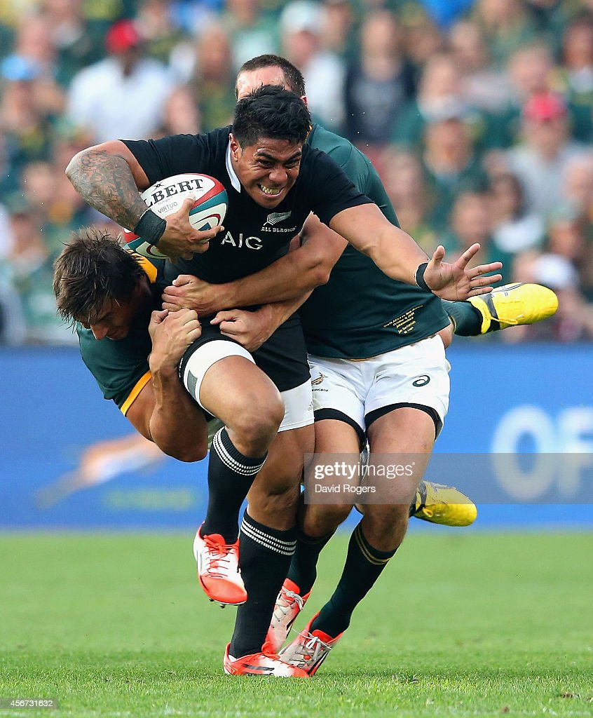 Malakai Fekitoa of the All Blacks is tackled by Eben Etzebeth (L) and Jan Serfontein during the Rugby Championship match between the South African Springboks and the New Zealand All Blacks at Ellis Park Stadium on October 4, 2014 in Johannesburg, South Africa.
