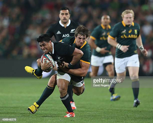 Malakai Fekitoa of the All Blacks is tackled by Eben Etzebeth during the Rugby Championship match between the South African Springboks and the New...