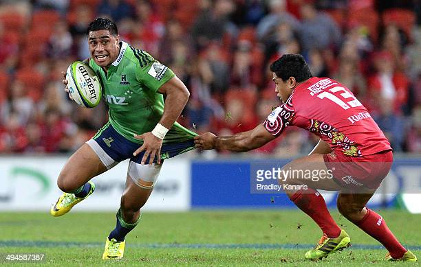 Malakai Fekitoa of the Highlanders attempts to break free from the defence during the round 16 Super Rugby match between the Reds and the Highlanders...