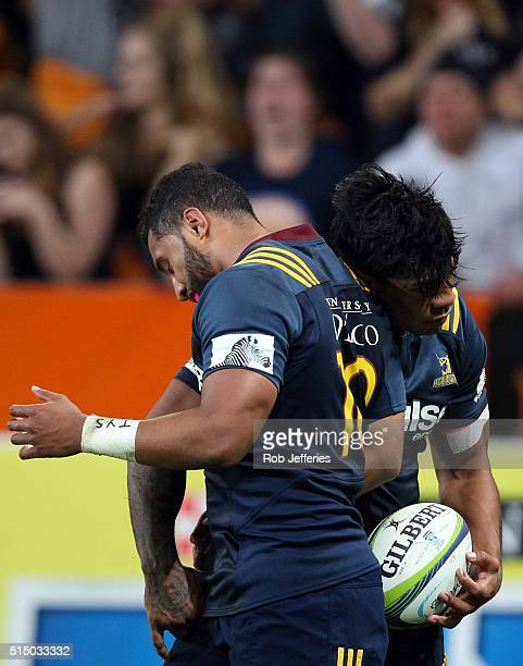 Malakai Fekitoa of the Highlanders celebrates his try with Lima Sopoaga during the round three Super Rugby match between the Highlanders and the...