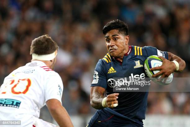 Malakai Fekitoa of the Highlanders fends off Lachlan Boshier of the Chiefs during the round one Super Rugby match between the Highlanders and the...