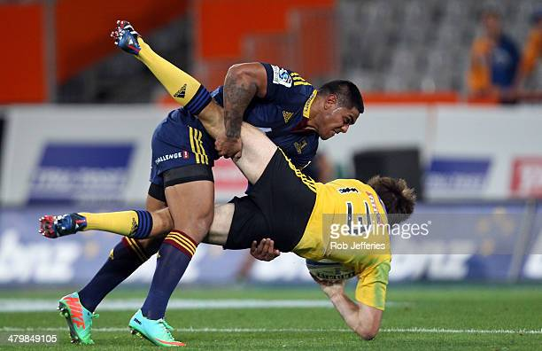 Malakai Fekitoa of the Highlanders hits Conrad Smith in a tackle during the round six Super Rugby match between the Highlanders and the Hurricanes at...