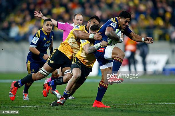 Malakai Fekitoa of the Highlanders is tackled during the Super Rugby Final match between the Hurricanes and the Highlanders at Westpac Stadium on...