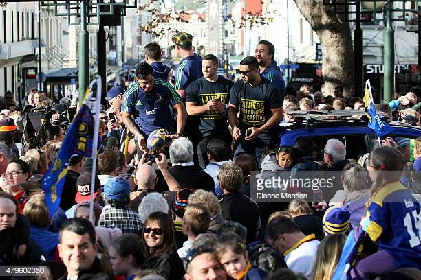 Malakai Fekitoa of the Highlanders makes his way through the crowd during a street parade to celebrate the Highlanders Super Rugby Grand Final...