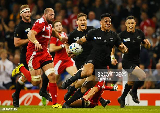 Malakai Fekitoa of the New Zealand All Blacks breaks to score their seventh try during the 2015 Rugby World Cup Pool C match between New Zealand and...