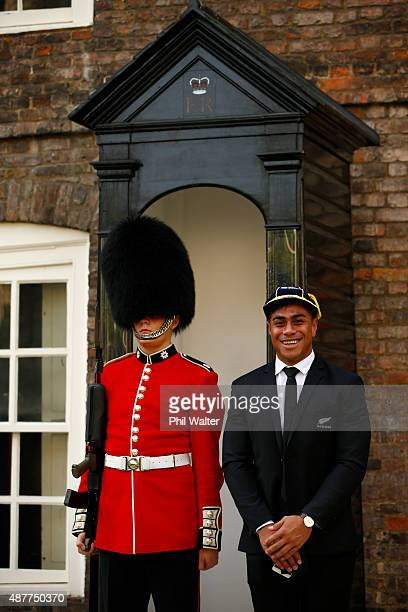Malakai Fekitoa of the New Zealand All Blacks stands alongside a Queens Guard following their RWC 2015 Welcome Ceremony at the Tower of London on...