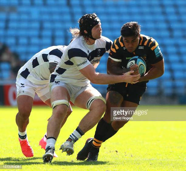 Malakai Fekitoa of Wasps is tackled by Ed Holmes during the Gallagher Premiership Rugby match between Wasps and Bristol Bears at the Ricoh Arena on...