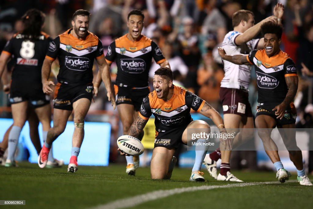 Malakai Watene-Zelezniak of the Tigers celebrates with his team mates after scoring the winning try during the round 23 NRL match between the Wests Tigers and the Manly Sea Eagles at Leichhardt Oval on August 13, 2017 in Sydney, Australia.
