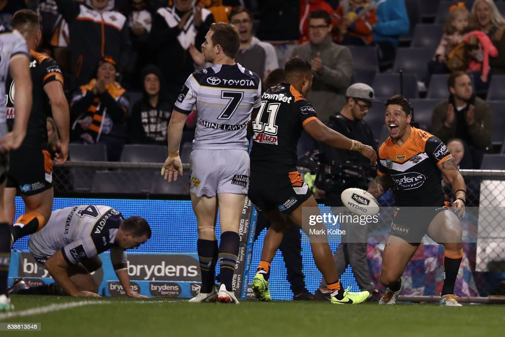 Malakai Watene-Zelezniak of the Tigers celebrates with his team mates after scoring a try during the round 25 NRL match between the Wests Tigers and the North Queensland Cowboys at Campbelltown Sports Stadium on August 25, 2017 in Sydney, Australia.