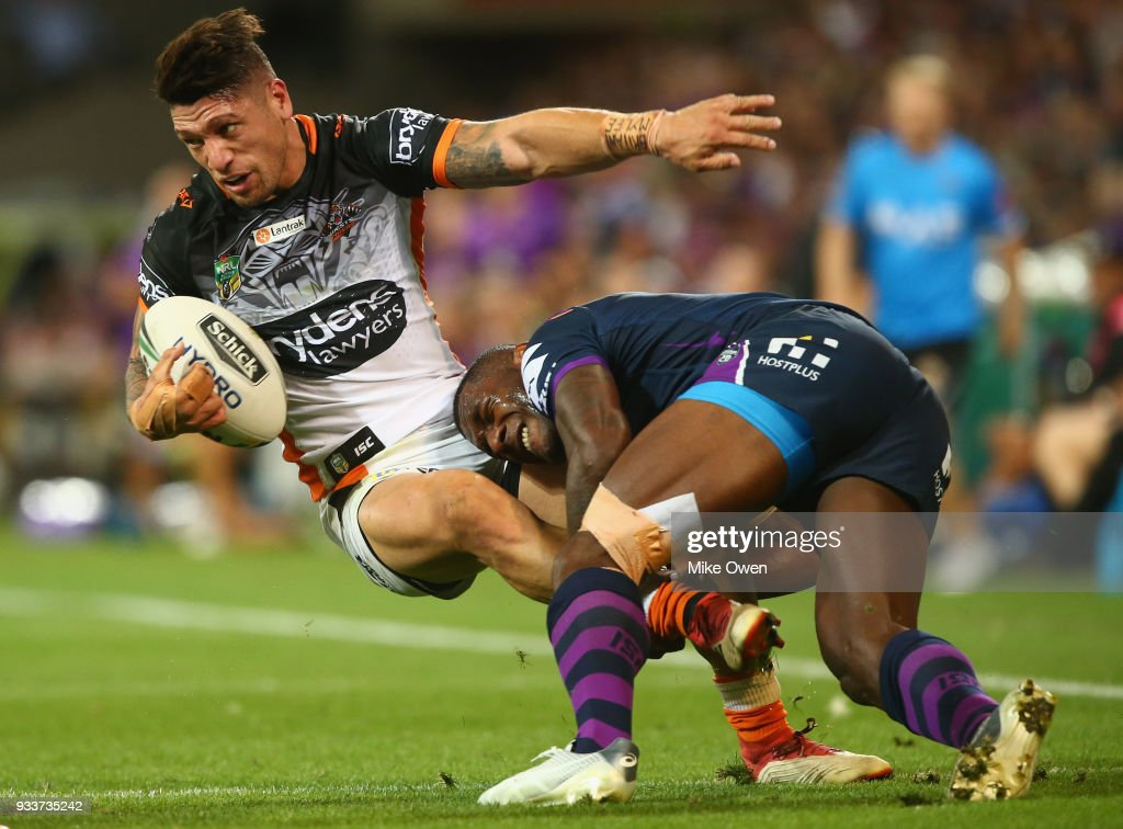 Malakai Watene-Zelezniak of the Tigers is tackled by Suliasi Vunivalu of the Storm during the round two NRL match between the Melbourne Storm and the Wests Tigers at AAMI Park on March 17, 2018 in Melbourne, Australia.